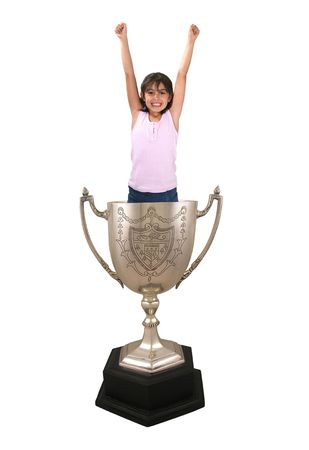 greatest: A photo of a girl celebrating inside a trophy cup Stock Photo