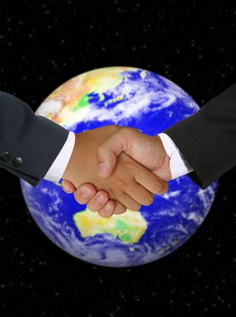 Men shaking hands in a global business deal