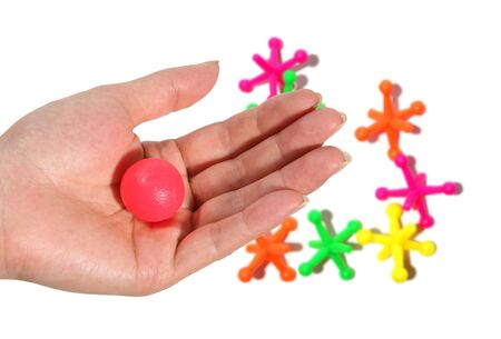 A female playing jacks toy game Stock Photo - 500813