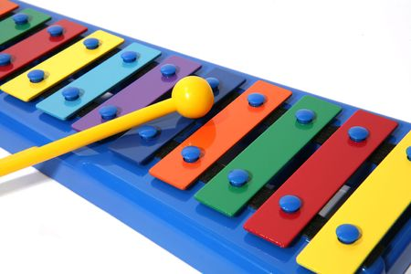 Colorful xylophone over white photo