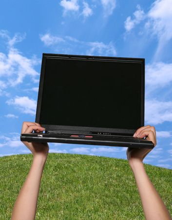 Woman holding laptop in the sky