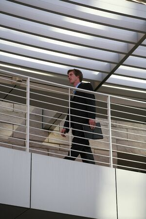 A business man walking in his office building Stock Photo - 603462