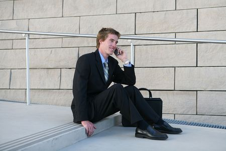 A business man talking on the cell phone while on break Stock Photo - 603440