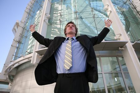 A business man celebrating success outside the office building Stock Photo - 603438