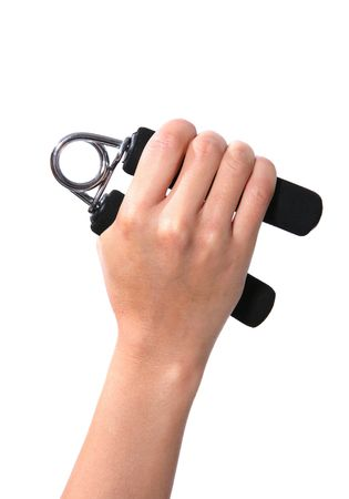 A woman squeezing a forearm exercise tool Stock Photo - 603437