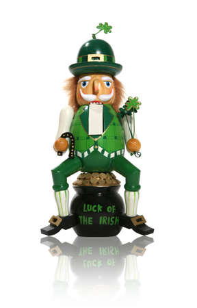 A leprechaun figure sitting on a pot of gold for Saint Patricks Day