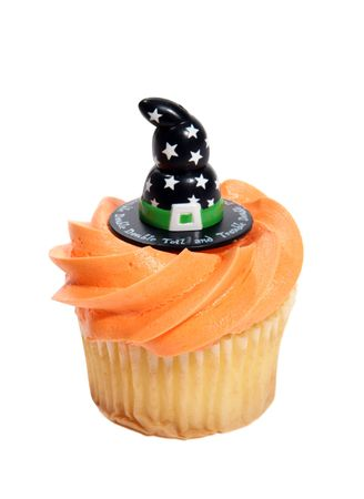 A halloween cupcake with a witches hat photo