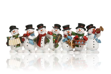 Snowmen playing music instruments isolated over white photo