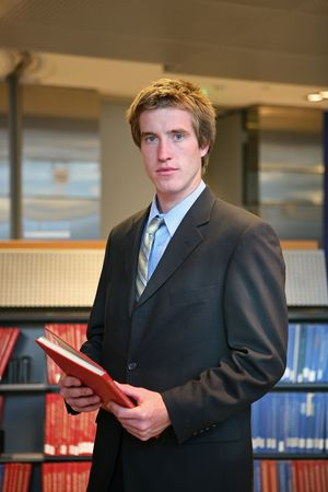 A lawyer in the library preparing for a case Stock Photo - 607691