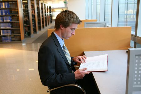 A business man preparing in the library