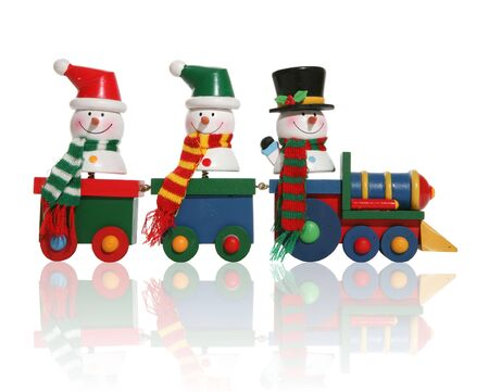 christmas train: Colorful snowmen riding on a toy train