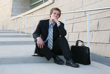 convinced: A confident business man outside his place of work
