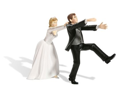 A funny figurine of a groom having second thought at his wedding