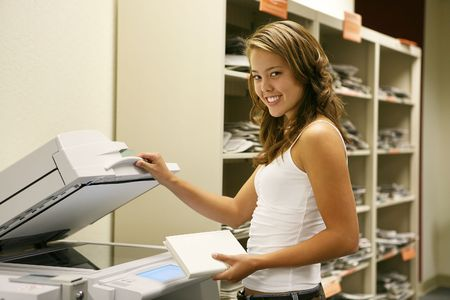 A student in the school library making photocopies