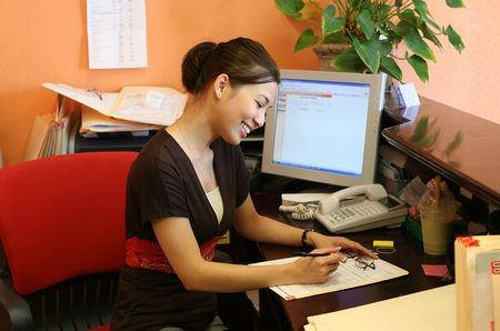 A woman receptionist working hard at the front desk