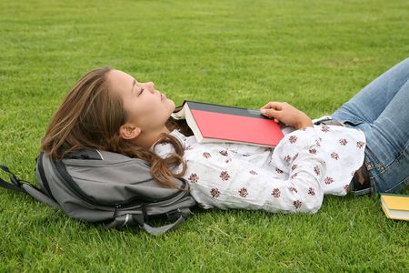 A young woman sleeping after reading a book photo