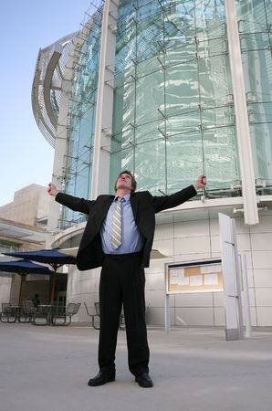 A business man celebrating success outside the office building Stock Photo - 637430
