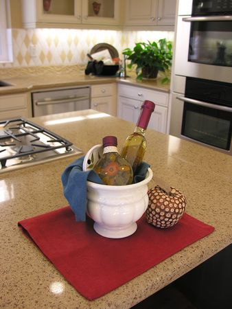 kitchen counter: Vinegar bottles on the kitchen counter inside an upscale home