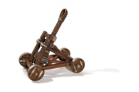 A wooden trebuchet catapult isolated over white