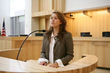 A pretty young woman testifying in court photo