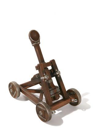 A wooden trebuchet catapult isolated over white photo