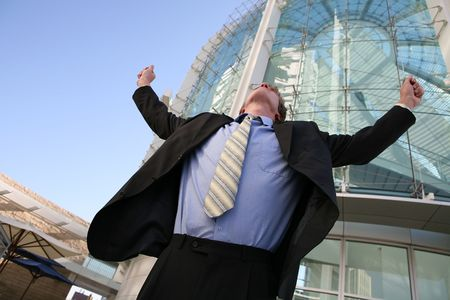 A business man celebrating success outside his office building Stock Photo - 648073