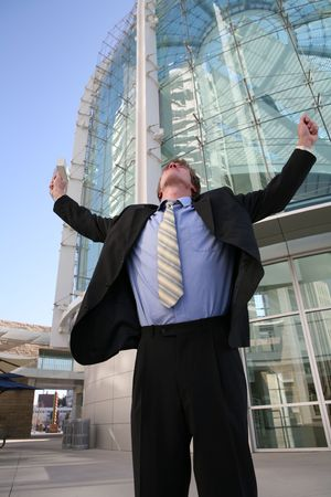 A business man celebrating success outside his office building Stock Photo - 648062