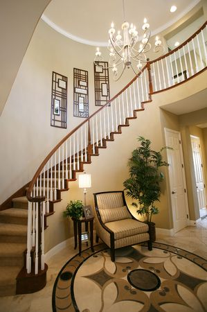 A staircase and entry way in a beautiful home interior