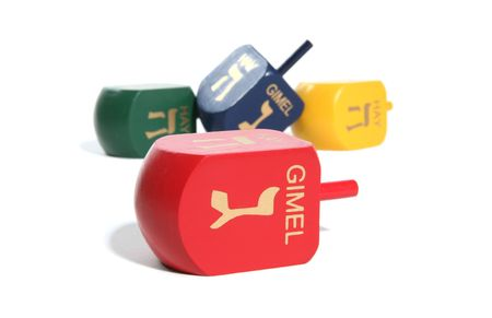 Four Colorful Dreidel Toys isolated over white