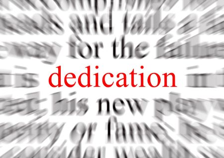 deliberation: Blurred text with a focus on dedication Stock Photo