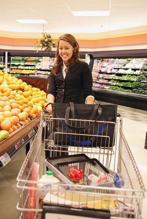 A beautiful woman shopping in the grocery store