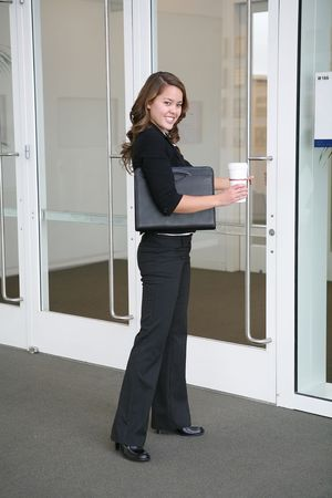 A beautiful business woman entering the office photo