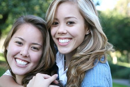 Two attractive sisters displaying the love of family Stock Photo - 697859