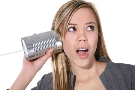 A cute business woman on an old can phone acting surprised Stock Photo - 706230