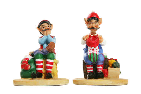 mythical festive: Colorful santas elves at Christmas over white
