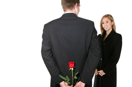 A man giving his girlfriend a rose at Valentines day in a display of love