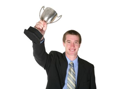 A business man holding a trophy in a sign of success Stock Photo - 715676