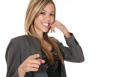 A beautiful business woman simulating a phone call