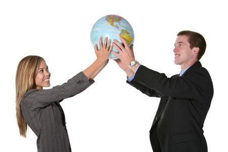 A business team holding up a globe of the earth Stock Photo - 715686