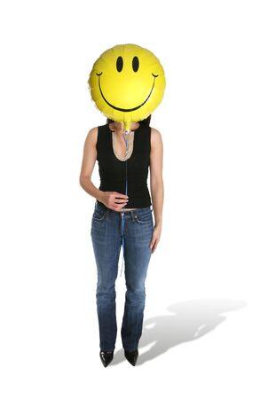 A woman holding a smiley face balloon Stock Photo - 724091