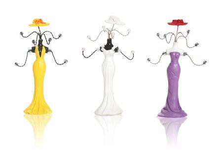 coathangers: Three coathangers styled in womens fashion dresses Stock Photo