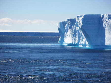 A large iceberg floating in the ocean in Antarctica 스톡 콘텐츠