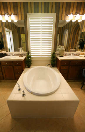 A nice bathroom with large bathtub in an upscale home Stock Photo - 744333