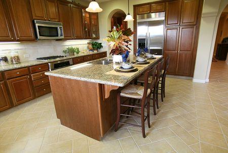 fridge lamp: A beautiful kitchen interior inside an upscale home Stock Photo