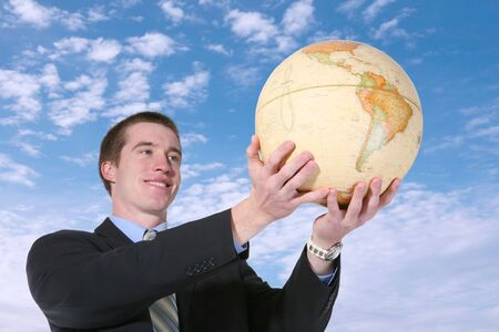 A business man holding a globe in the air photo