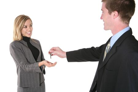 A business man handing his partner the keys to success Stock Photo - 755861