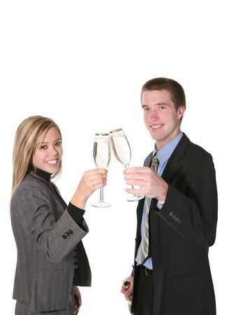 A couple in business attire celebrating a success with champagne