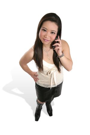 peppy: A cute asian woman on a cellular phone Stock Photo