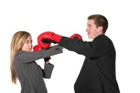 Rowdy: Two business people with boxing gloves on in the middle of conflict