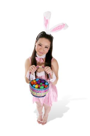 asian bunny: A cute asian woman dressed up as the easter bunny holding a basket of eggs Stock Photo